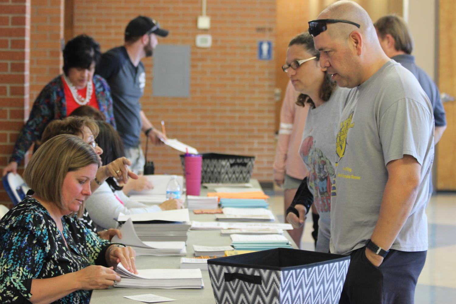 Parents check in during parent teacher conferences on September 28, 2017.