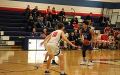 Sophomore Darrin Battiste dribbles down the court against the Manhattan Indians at Manhattan on Tuedays February 20th.