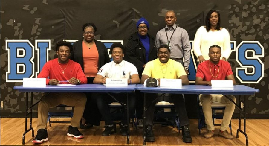 On+the+national+signing+day+seniors+Kenson+Henderson%2C+Davante+King%2C+Xavier+Cason%2C+and+Lucio+Norris+signed+to+play+collegiate+football.+
