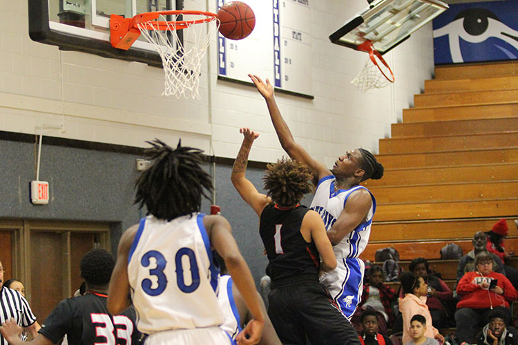 AJ Dickerson goes up for a layup at the home basketball game on Friday, February 2.